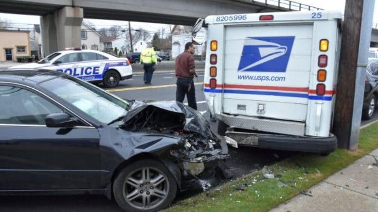 police driver hurt in crash with mail truck